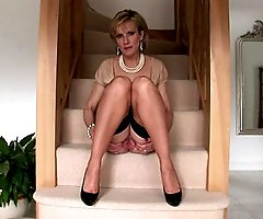 Spreading tease mature on the stair